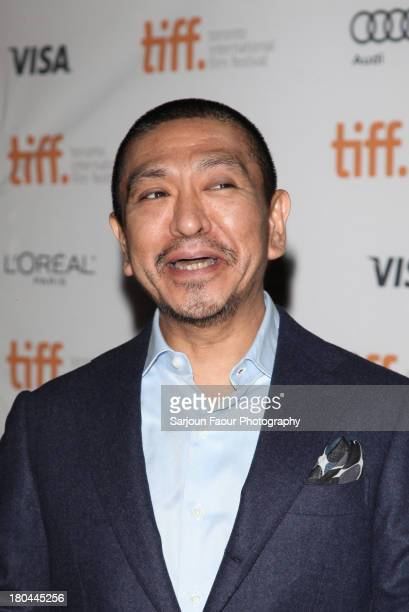 Director and actor Hitoshi Matsumoto arrives at the 'R100' Premiere during the 2013 Toronto International Film Festival at Ryerson Theatre on...
