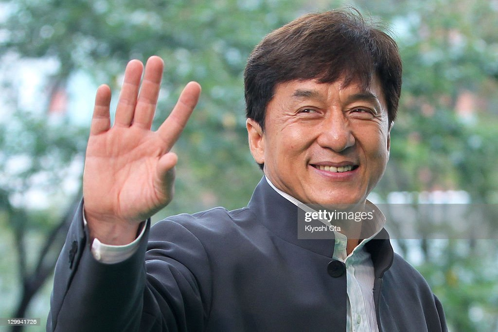 Director and actor <a gi-track='captionPersonalityLinkClicked' href=/galleries/search?phrase=Jackie+Chan&family=editorial&specificpeople=171455 ng-click='$event.stopPropagation()'>Jackie Chan</a> waves as he attends the 24th Tokyo International Film Festival (TIFF) Opening Ceremony at Roppongi Hills on October 22, 2011 in Tokyo, Japan. One of Asia's largest film festivals takes place from October 22 to 30, showcasing about 130 highly-selected films from a variety of genres in several programs including the 'Competition' section for the Tokyo Sakura Grand Prix.
