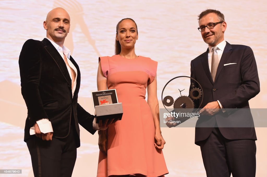 Director and actor James Franco holds his Jaeger Le Coultre Glory To The Filmmaker Award as Carmen Chaplin and JaegerLeCoultre Communication Director...