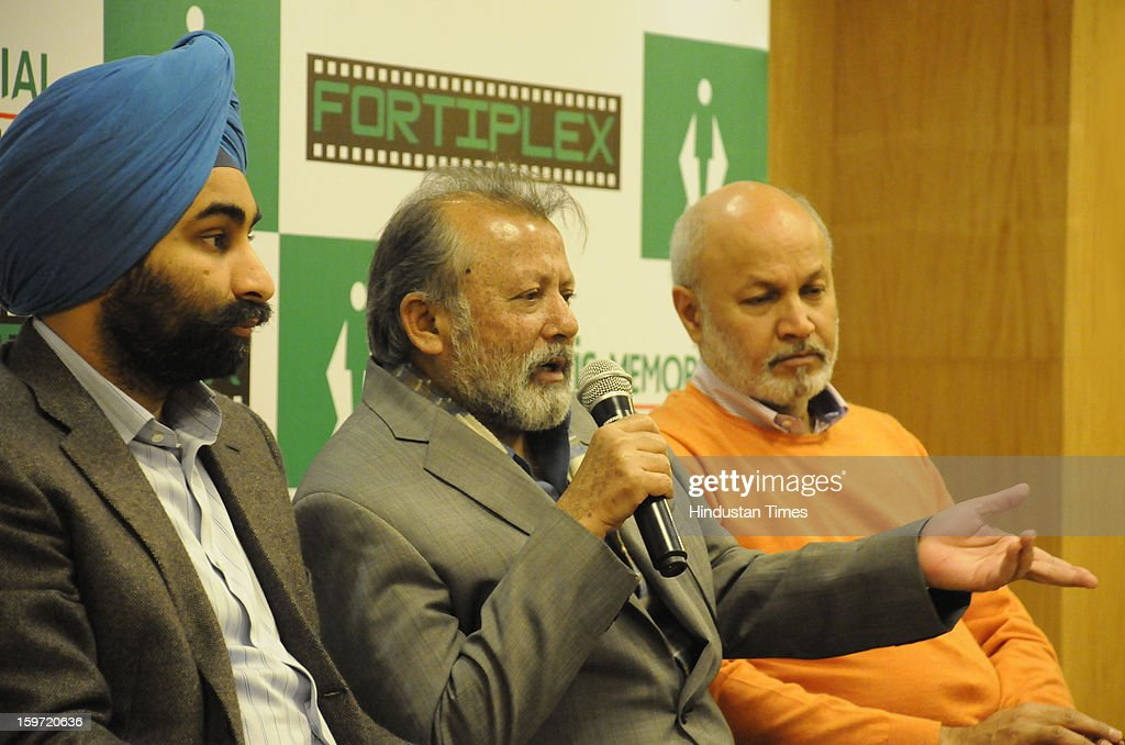 Director and actor Pankaj Kapoor (C) with Shivinder Mohan Singh, Executive Vice Chairman, Fortis Healthcare(L) during the Question & Answer session after the inaugurated Fortiplex in Fortis Memorial Research Institute sector- 44 on January 19,2013 in Gurgaon, India. Fortiplex is a A 36 seat movie theatre made for entertainment of the attendants.