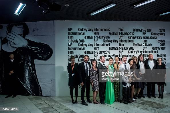 Director and actor Szabolcs Hajdu of Hungary poses for photographers with cast members after receiving the Grand Prix Crystal Globe Award for the...