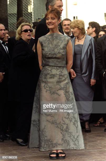 Director and actor Tim Robbins stands behind his wife actress Susan Sarandon arrive at the Palais des Festivals for the premiere of their film...