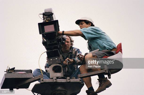 Director and cameraman on crane filming
