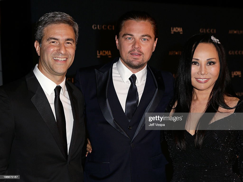 Director and CEO Michael Govan and Gala Co-Chairs <a gi-track='captionPersonalityLinkClicked' href=/galleries/search?phrase=Leonardo+DiCaprio&family=editorial&specificpeople=201635 ng-click='$event.stopPropagation()'>Leonardo DiCaprio</a> and <a gi-track='captionPersonalityLinkClicked' href=/galleries/search?phrase=Eva+Chow&family=editorial&specificpeople=649823 ng-click='$event.stopPropagation()'>Eva Chow</a>, wearing Gucci, attend the LACMA 2013 Art + Film Gala honoring Martin Scorsese and David Hockney presented by Gucci at LACMA on November 2, 2013 in Los Angeles, California.