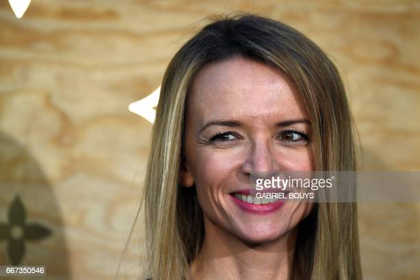 Director and executive Vice President of Louis Vuitton Delphine Arnault poses during a photocall ahead of a diner for the launch of a Louis Vuitton...