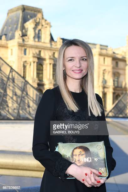 Director and executive Vice President of Louis Vuitton Delphine Arnault poses in front of the Louvre Pyramid in the main courtyard of the Louvre...