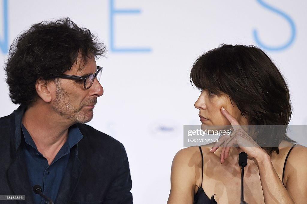 US director and President of the Feature Film jury Joel Coen and jury member French actress Sophie Marceau look at each other during a press...