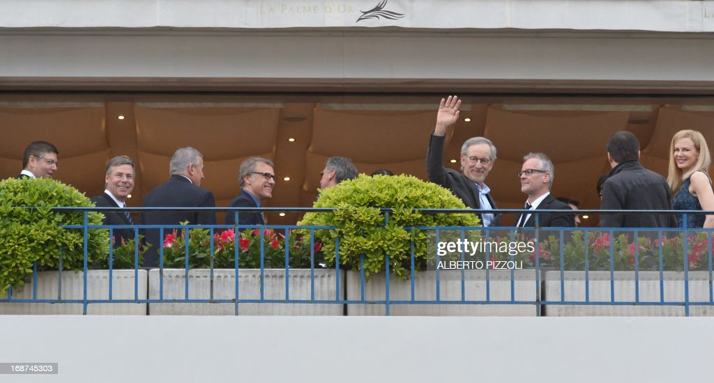 US director and President of the Feature Film Jury, Steven Spielberg (4thR), waves as he poses on May 14, 2013 with General Delegate of the Cannes Film Festival Thierry Fremaux (3rdR), and members of the Feature Film Jury Australian actress Nicole Kidman (R), Romanian director Cristian Mungiu (2ndR) and Austrian actor Christoph Waltz (4thL) on the balcony of the Grand-Hyatt Martinez Hotel in Cannes on the eve of the 66th edition of the Cannes Film Festival. Cannes, one of the world's top film festivals, opens on May 15 and will climax on May 26 with awards selected by a jury headed this year by Hollywood legend Steven Spielberg. AFP PHOTO / ALBERTO PIZZOLI