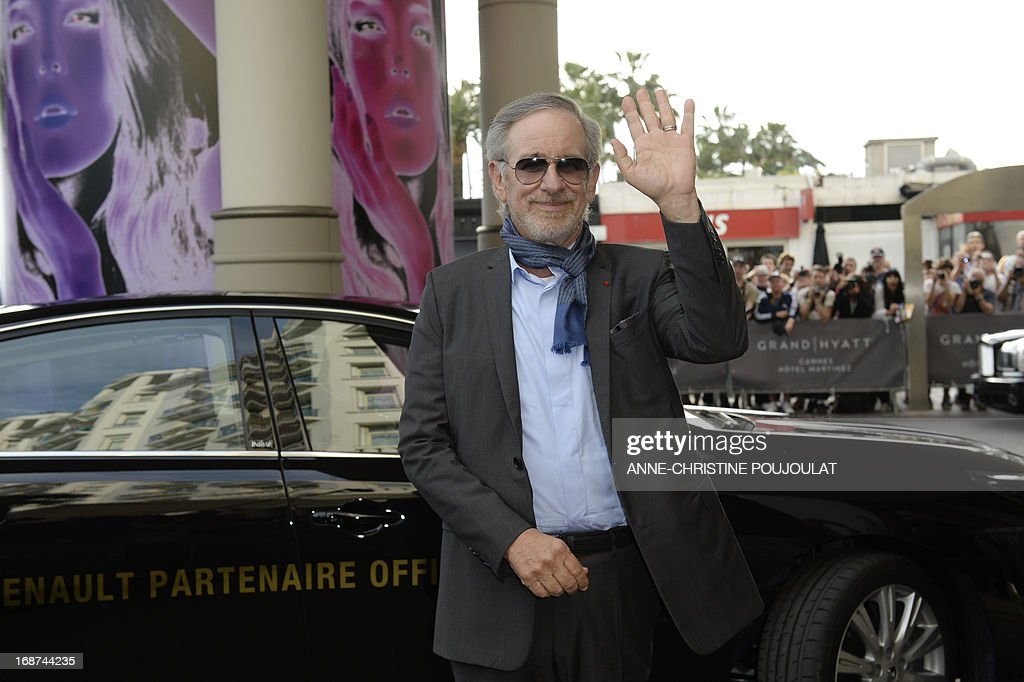 US director and President of the Feature Film Jury, Steven Spielberg, waves on May 14, 2013 as he arrives at the Martinez Hotel in Cannes to attend a photocall of the Jury on the eve of the 66th edition of the Cannes Film Festival. Cannes, one of the world's top film festivals, opens on May 15 and will climax on May 26 with awards selected by a jury headed this year by Hollywood legend Steven Spielberg. AFP PHOTO / ANNE-CHRISTINE POUJOULAT