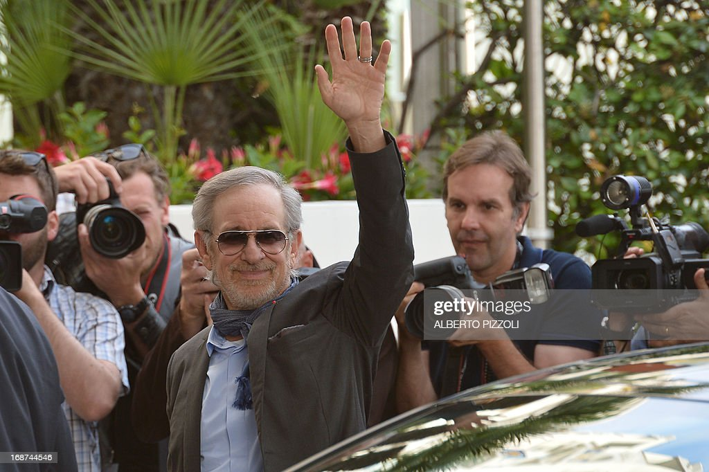 US director and President of the Feature Film Jury Steven Spielberg waves on May 14, 2013 as he arrives at the Martinez Hotel in Cannes to attend a photocall of the Jury on the eve of the 66th edition of the Cannes Film Festival. Cannes, one of the world's top film festivals, opens on May 15 and will climax on May 26 with awards selected by a jury headed this year by Hollywood legend Steven Spielberg.