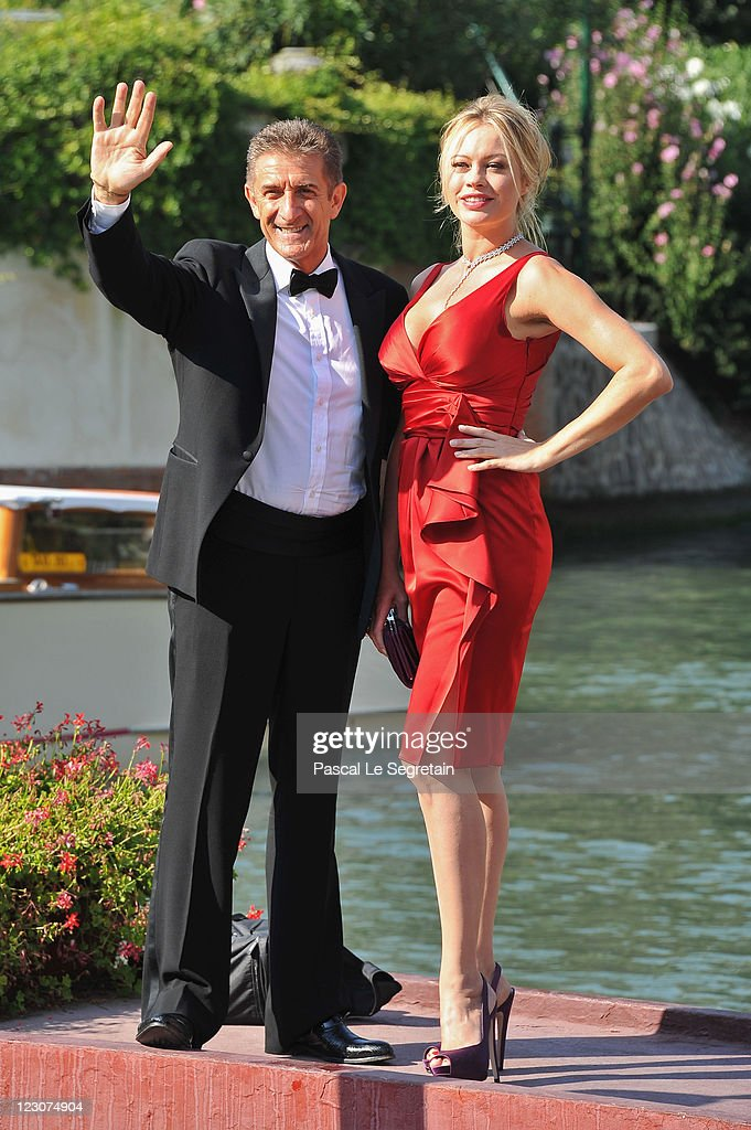 Director and Producer Ezio Greggio and actress Anna Falchi attends the 68th Venice Film Festival on August 30 2011 in Venice Italy