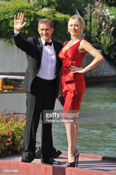 Director and Producer Ezio Greggio and actress Anna Falchi attends the 68th Venice Film Festival on August 30 2011 in Venice Italy