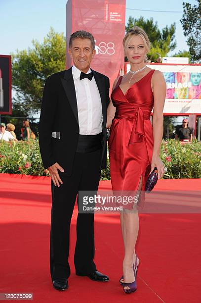 Director and Producer Ezio Greggio and actress Anna Falchi attends 'Box Office 3D' premiere during the 68th Venice International Film Festival at...
