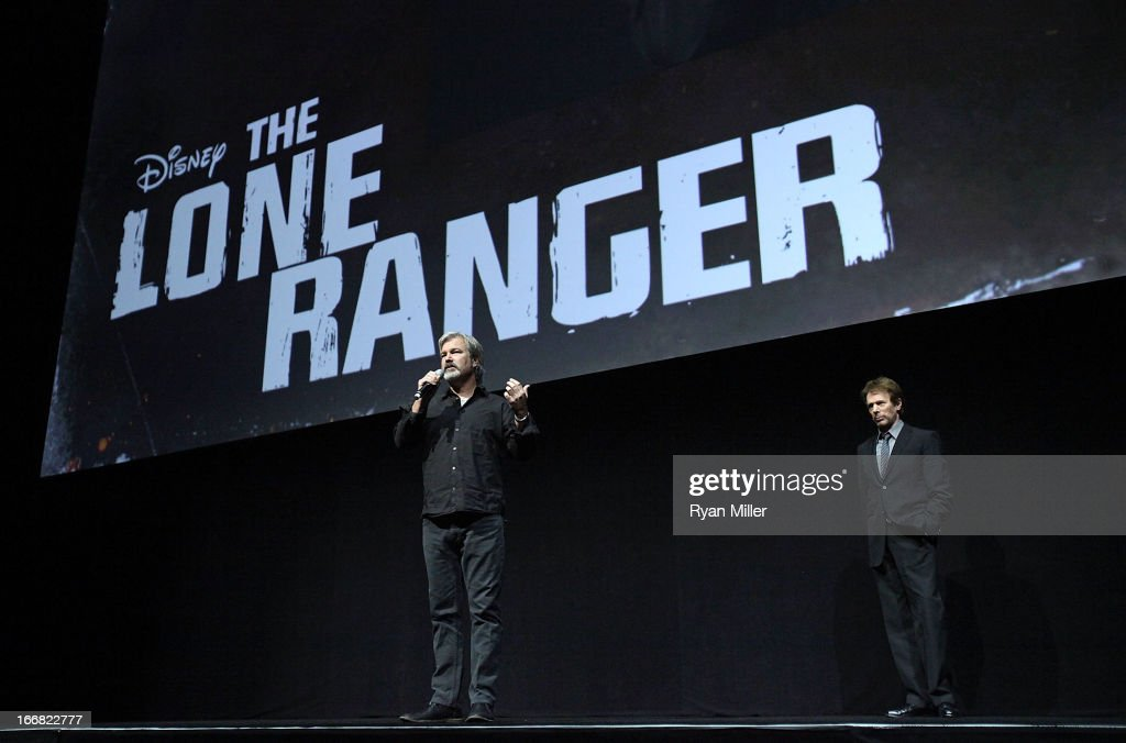 Director and producer Gore Verbinski and producer Jerry Bruckheimer speak onstage during The Walt Disney Studios Invites You to an Exclusive...