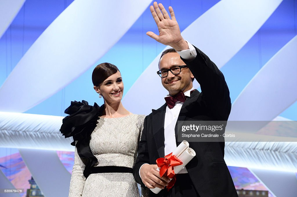 Director and Screenwriter Andrei Zvyagintsev receives the Best Screenplay Prize for his film 'Leviathan' from Paz Vega at the Closing Ceremony during 67th Cannes Film Festival