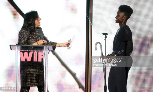 Director and The BMW Dorothy Arzner Directors Award Honoree Mira Nair wearing 'S Max Mara receives award presented by Lupita Nyong'o wearing Max Mara...