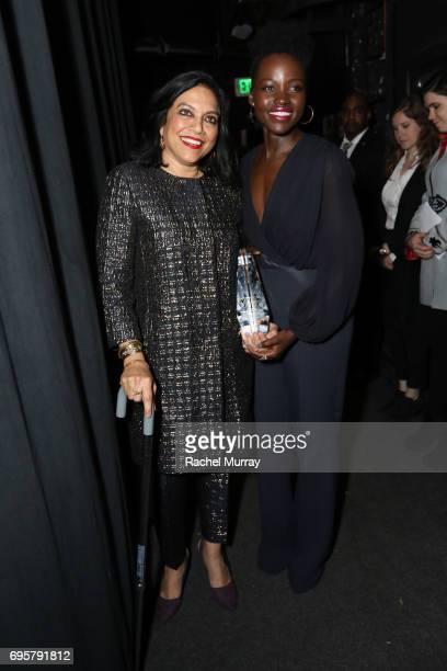 Director and The BMW Dorothy Arzner Directors Award Honoree Mira Nair wearing 'S Max Mara and actress Lupita Nyong'o wearing Max Mara attend the...