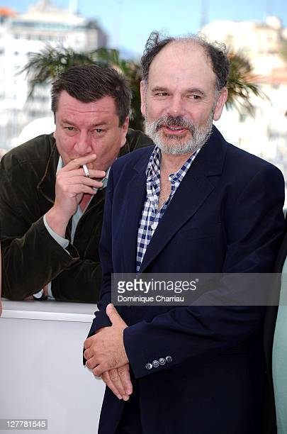 Director and writer Aki Kaurismaki and actor JeanPierre Darroussin attend the 'La Havre' Photocall at the Palais des Festivals during the 64th Cannes...