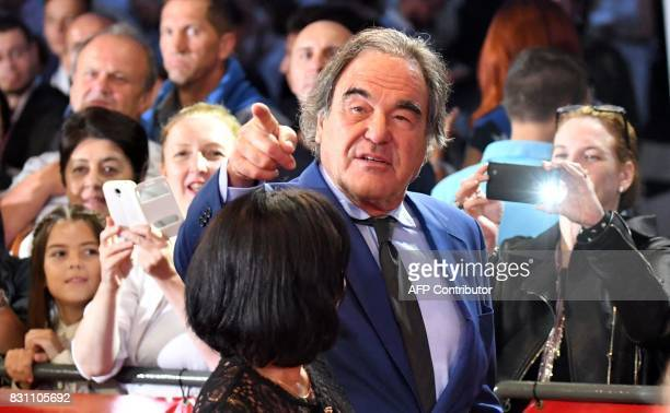 US director and writer Oliver Stone and his wife Chong Son Stone pose as they arrive for the award ceremony of 23rd Sarajevo Film Festival late on...