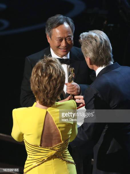 Director Ang Lee accepts the Best Director award for 'Life of Pi' from actor Michael Douglas and actress Jane Fonda onstage during the Oscars held at...