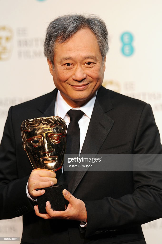 Director Ang Lee accepts the Cinematography award for Claudio Miranda in the press room at the EE British Academy Film Awards at The Royal Opera House on February 10, 2013 in London, England.