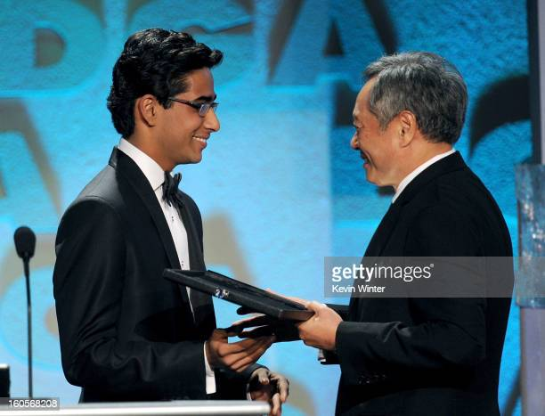 Director Ang Lee accepts the Feature Film Nomination Plaque for 'Life of Pi' from actor Suraj Sharma onstage during the 65th Annual Directors Guild...
