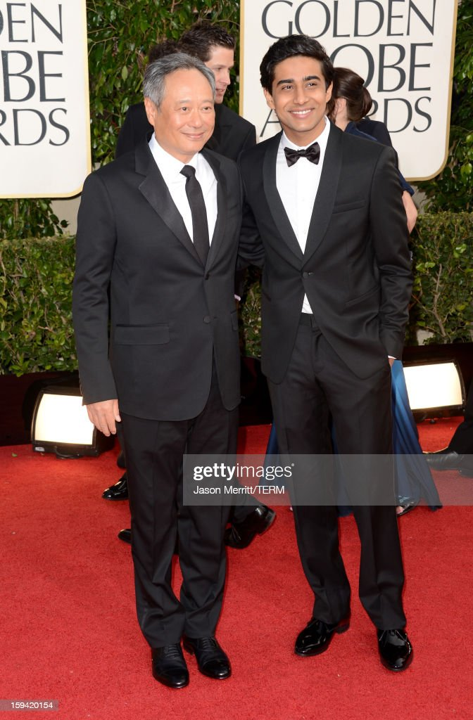 Director Ang Lee (L) and actor Suraj Sharma arrive at the 70th Annual Golden Globe Awards held at The Beverly Hilton Hotel on January 13, 2013 in Beverly Hills, California.