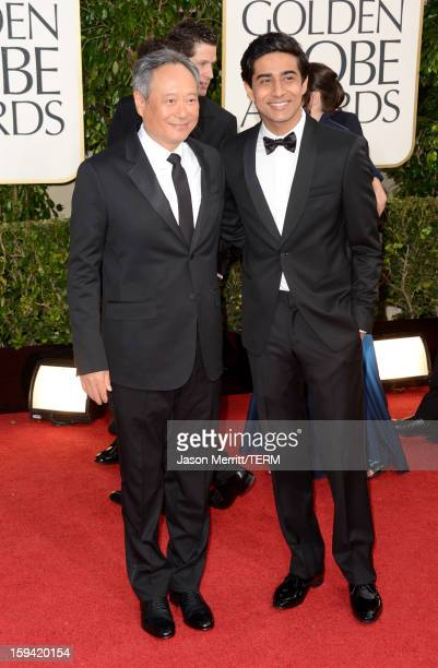 Director Ang Lee and actor Suraj Sharma arrive at the 70th Annual Golden Globe Awards held at The Beverly Hilton Hotel on January 13 2013 in Beverly...
