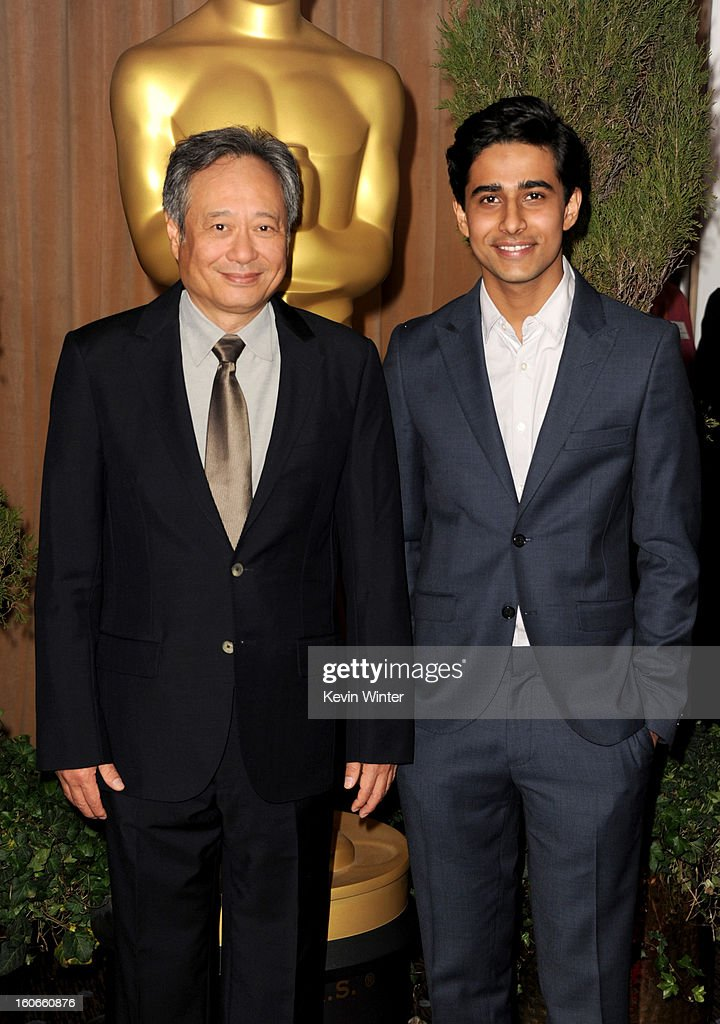 Director <a gi-track='captionPersonalityLinkClicked' href=/galleries/search?phrase=Ang+Lee&family=editorial&specificpeople=215104 ng-click='$event.stopPropagation()'>Ang Lee</a> (L) and actor <a gi-track='captionPersonalityLinkClicked' href=/galleries/search?phrase=Suraj+Sharma&family=editorial&specificpeople=9768453 ng-click='$event.stopPropagation()'>Suraj Sharma</a> attend the 85th Academy Awards Nominations Luncheon at The Beverly Hilton Hotel on February 4, 2013 in Beverly Hills, California.