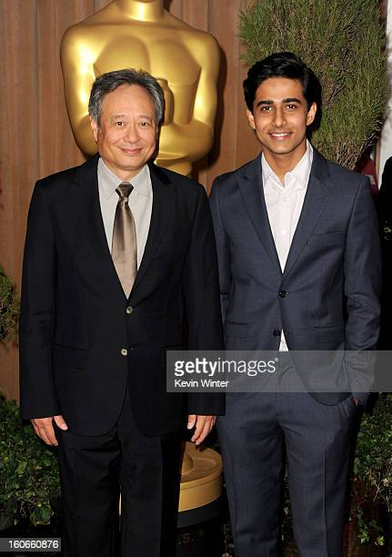 Director Ang Lee and actor Suraj Sharma attend the 85th Academy Awards Nominations Luncheon at The Beverly Hilton Hotel on February 4 2013 in Beverly...