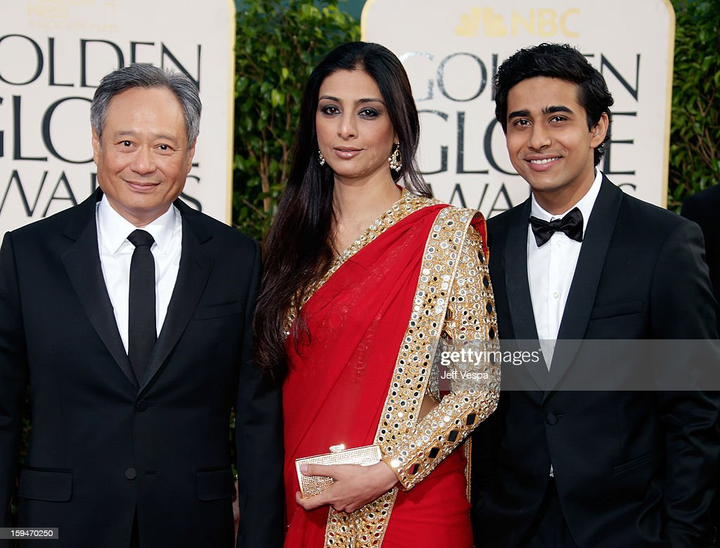 Director <a gi-track='captionPersonalityLinkClicked' href=/galleries/search?phrase=Ang+Lee&family=editorial&specificpeople=215104 ng-click='$event.stopPropagation()'>Ang Lee</a> and actors Tabu and <a gi-track='captionPersonalityLinkClicked' href=/galleries/search?phrase=Suraj+Sharma&family=editorial&specificpeople=9768453 ng-click='$event.stopPropagation()'>Suraj Sharma</a> arrive at the 70th Annual Golden Globe Awards held at The Beverly Hilton Hotel on January 13, 2013 in Beverly Hills, California.