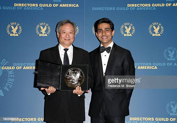 "Director Ang Lee recipient of the Feature Film Nomination Plaque for ""Life of Pi' and presenter Suraj Sharma pose in the press room during the 65th..."
