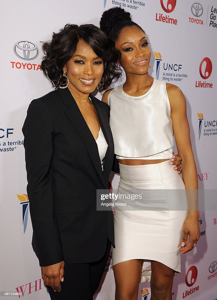Director Angela Bassett and actress Yaya DaCosta arrive at the premiere of Lifetime's 'Whitney' at The Paley Center for Media on January 6, 2015 in Beverly Hills, California.
