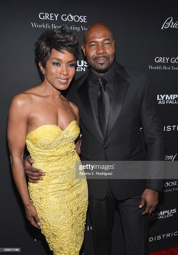 Director Antoine Fuqua (L) and actress Angela Bassett arrive at the premiere of FilmDistrict's 'Olympus Has Fallen' at ArcLight Cinemas Cinerama Dome on March 18, 2013 in Hollywood, California.