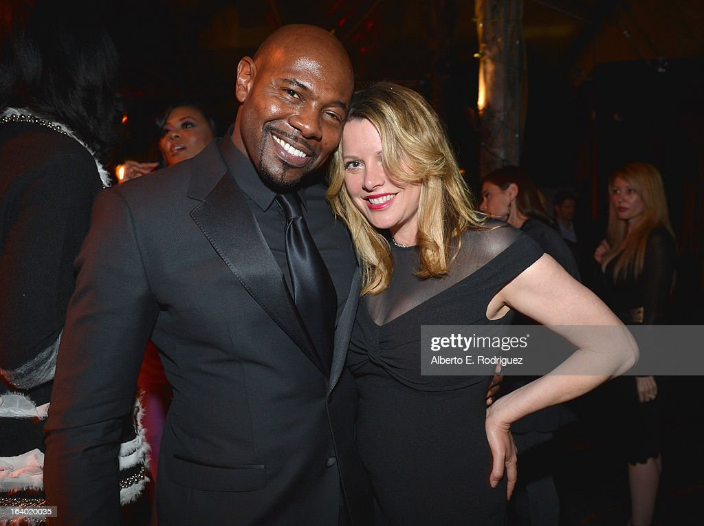 Director Antoine Fuqua and executive producer Meidi Jo Markel attend the after party for the premiere of FilmDistrict's 'Olympus Has Fallen' at Lure on March 18, 2013 in Hollywood, California.