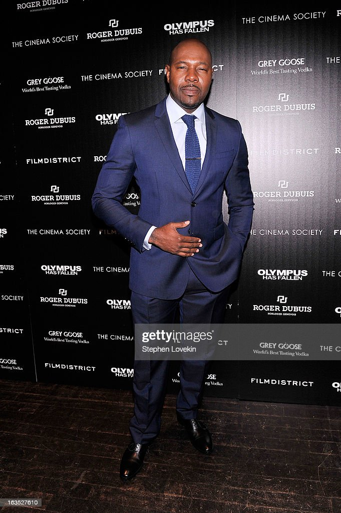 Director <a gi-track='captionPersonalityLinkClicked' href=/galleries/search?phrase=Antoine+Fuqua&family=editorial&specificpeople=2480782 ng-click='$event.stopPropagation()'>Antoine Fuqua</a> attends The Cinema Society with Roger Dubuis and Grey Goose screening of FilmDistrict's 'Olympus Has Fallen' at Tribeca Grand Hotel on March 11, 2013 in New York City.