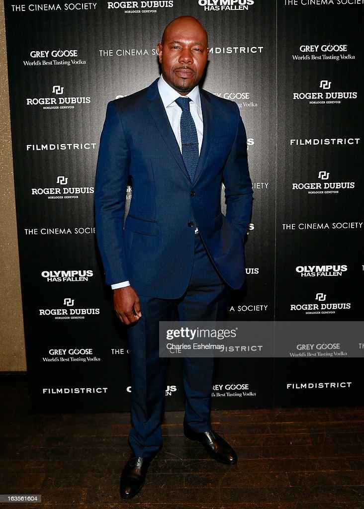 Director Antoine Fuqua attends The Cinema Society with Roger Dubuis and Grey Goose screening of FilmDistrict's 'Olympus Has Fallen' at the Tribeca Grand Screening Room on March 11, 2013 in New York City.