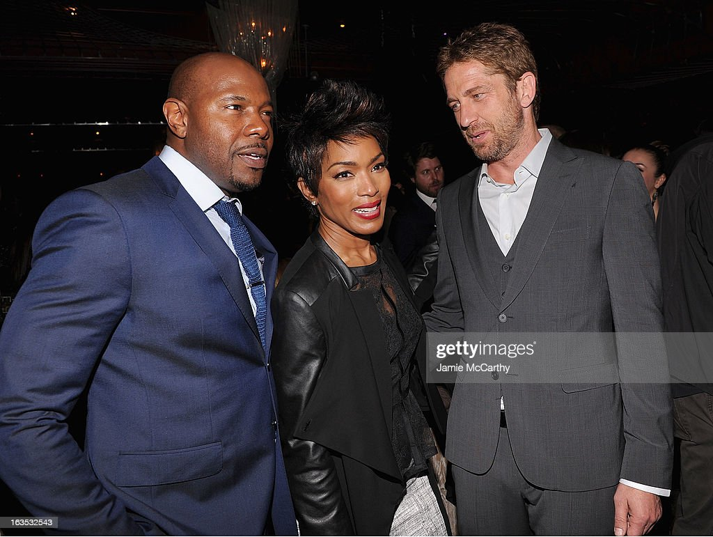 Director Antoine Fuqua,Angela Bassett and Gerard Butler attend the after party for The Cinema Society with Roger Dubuis and Grey Goose screening of FilmDistrict's 'Olympus Has Fallen' at The Darby on March 11, 2013 in New York City.