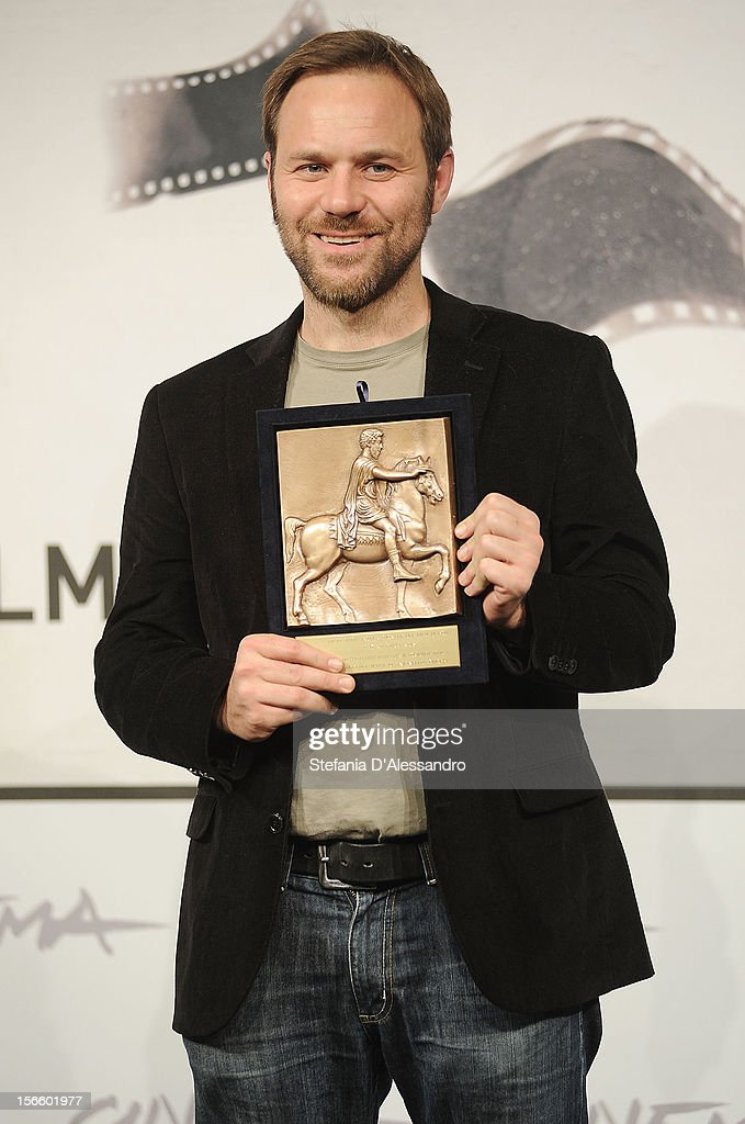 Director Antonello Schioppa poses with his Prospettive Award for Best Short Film during the Award Winners Photocall on November 17, 2012 in Rome, Italy.