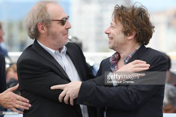 Director Arnaud Desplechin and actor Mathieu Amalric attend the 'Ismael's Ghosts ' photocall during the 70th annual Cannes Film Festival at Palais...
