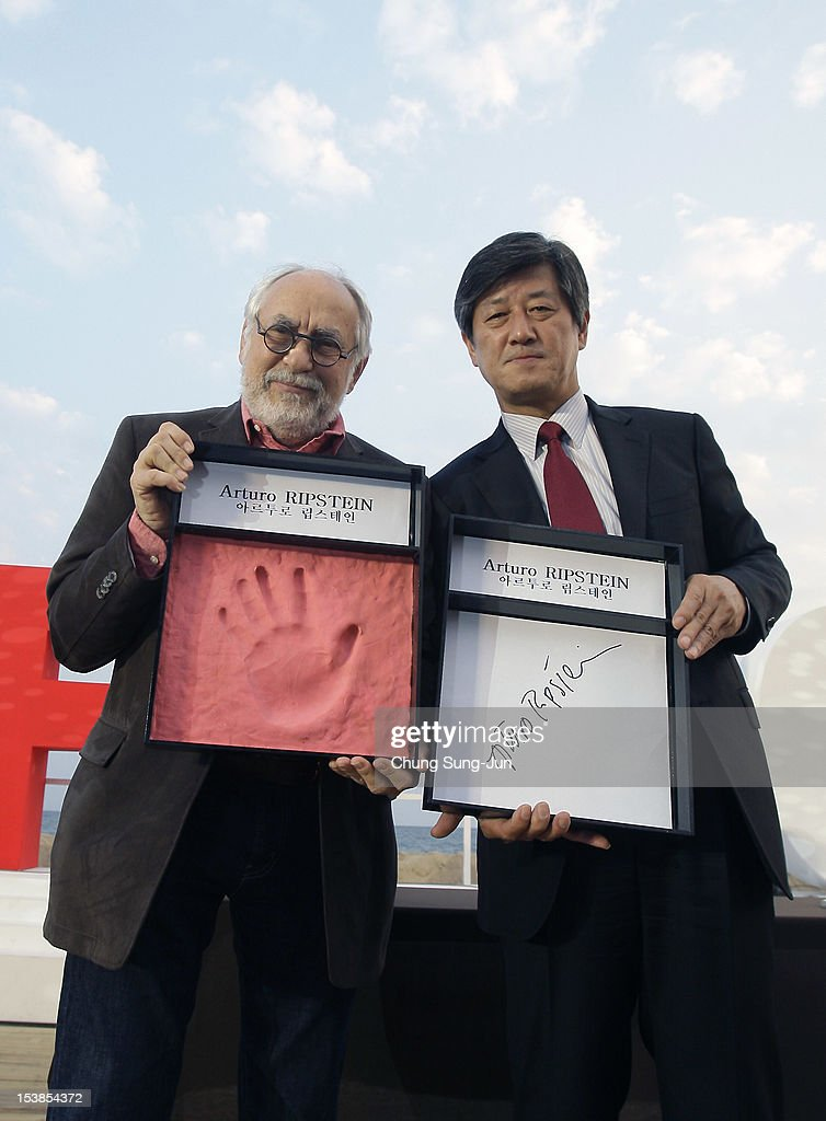 Director Arturo Ripstein (L) and festival director Lee Yong-Kwan attend Hand Printing Ceremony during the 17th Busan International Film Festival (BIFF) at the Haeundae Beach on October 10, 2012 in Busan, South Korea. The biggest film festival in Asia showcases 304 films from 75 countries and runs from October 4-13.