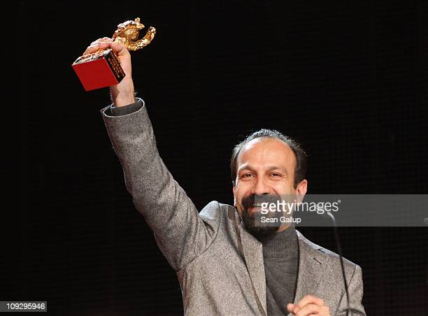 Director Asghar Farhadi of Iranian movie 'Jodaeiye Nader Az Simin' receives the Golden EBar for best movie at the Award Ceremony during day ten of...