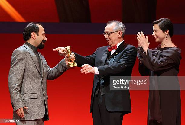 Director Asghar Farhadi of Iranian movie 'Jodaeiye Nader Az Simin' receives the Golden Bear for best movie from jury member Isabella Rossellini and...