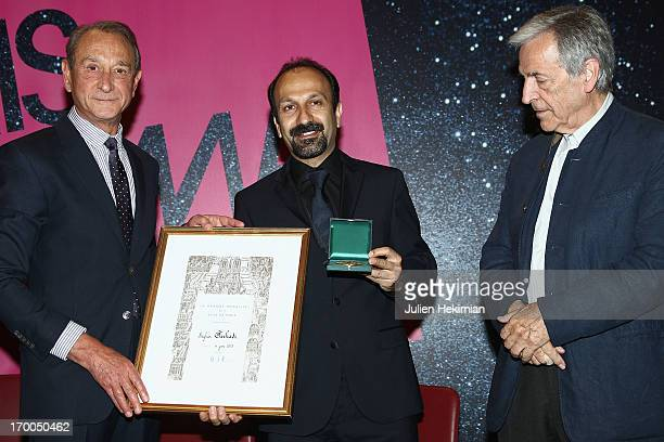 Director Ashgar Farhadi is pictured with French Mayor of Paris Bertrand Delanoe and Costa Gavras while he Receives Vermeil Medal Of The City Of Paris...