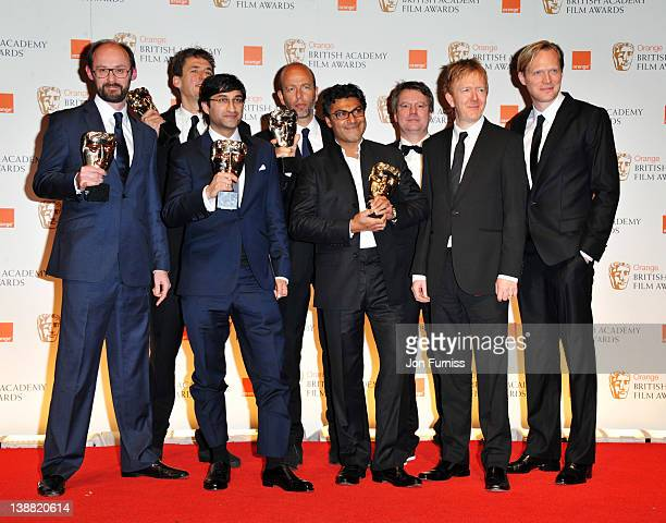 Director Asif Kapadia poses with the other producers in the press room with the Documentary award with actor Paul Bettany during the Orange British...