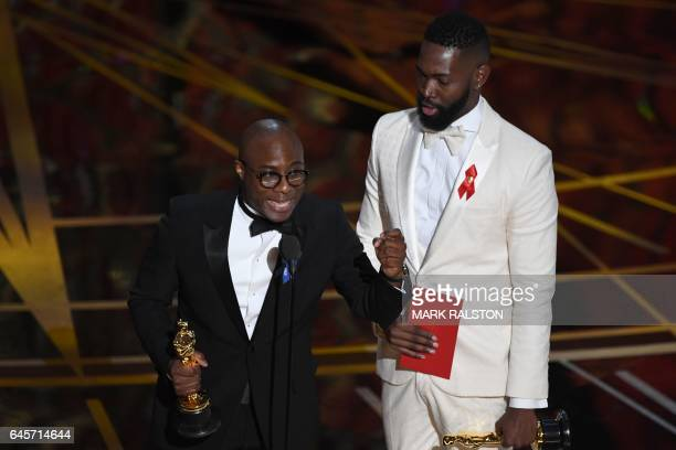 US director Barry Jenkins delivers a speech on stage next to US writer Tarell Alvin McCraney after they won the Best Adapted Screenplay for...