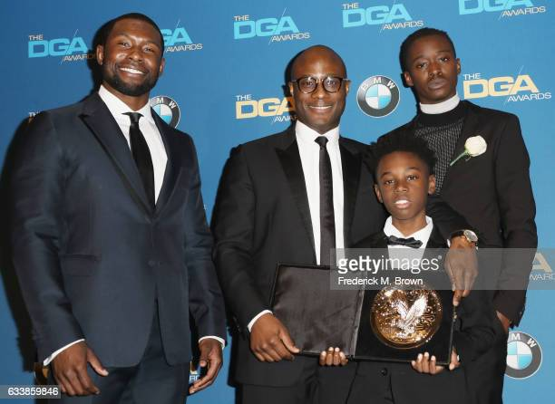 "Director Barry Jenkins recipient of the Feature Film Nomination Plaque for ""Moonlight"" poses in with actors Trevante Rhodes Alex Hibbert and Ashton..."