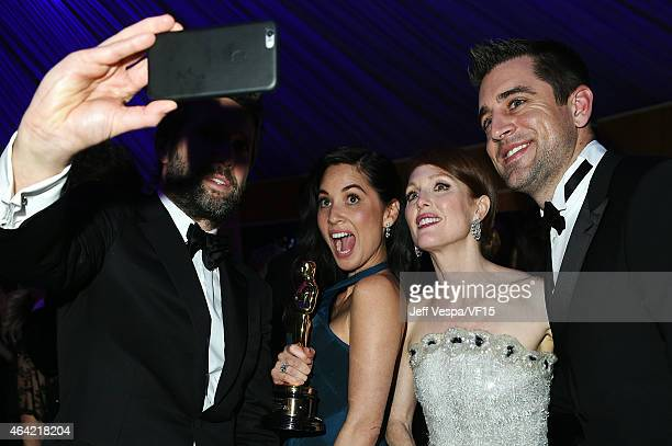 Director Bart Freundlich actress Olivia Munn actress Julianne Moore and NFL player Aaron Rodgers pose for a selfie photo at the 2015 Vanity Fair...