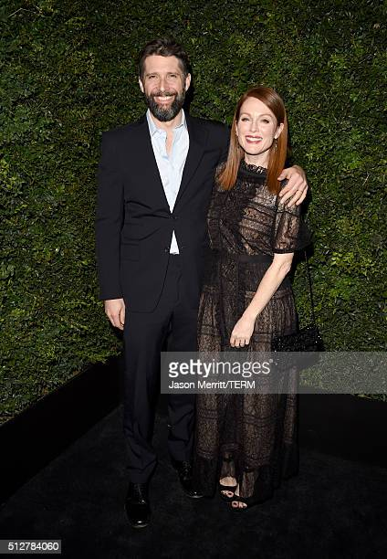 Director Bart Freundlich and actress Julianne Moore attend the Charles Finch and Chanel PreOscar Awards Dinner at Madeo Restaurant on February 27...