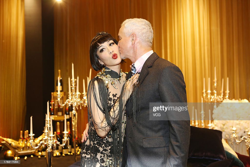 Director Baz Luhrmann and actress Christy Chung attend 'The Great Gatsby' premiere at China World Trade Center Tower 3 on August 28, 2013 in Beijing, China.